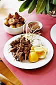 Lamb kebabs and caramelised potatoes with tamari and ginger