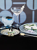 Herb sandwiches with caviar and a Gibson cocktail