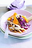 Red cabbage and pear salad with pumpkins and hazelnuts