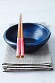 A bowl and chopsticks
