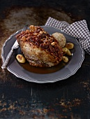 Crispy roast pork with bread dumplings and potatoes