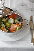 Casserole with salmon fillet, vegetables and mustard