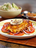 Fish Meen Columbu (fish curry, South India) on tomato salad