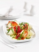 Melons with raw ham and rocket