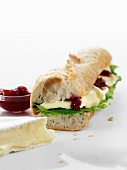Baguette sandwich with brie and marmalade