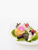 Cheese platter with edible flowers and fruit