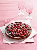 Chilli and chocolate tart topped with fresh raspberries