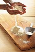 A hands holding flour