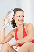 A sporty woman with a bottle of water