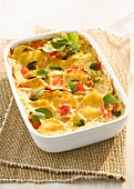 Potato bake with tomatoes and parsley