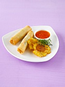 Spring rolls with banana chips and chilli sauce
