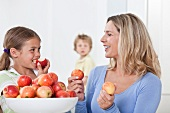 A family eating apples