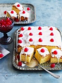 Tray-bake cake decorated with icing sugar and raspberries
