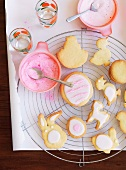 Easter biscuits decorated with icing sugar on a wire rack