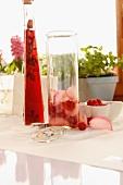 Raspberry vinegar and raspberry and rose vinaigrette being prepared