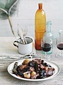 Conejo con ciruelas pasas (braised chicken with baked plums, Basque Country)