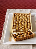 Macadamia nut tart with golden syrup