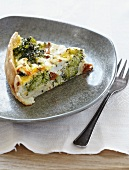 A slice of broccoli quiche with dried tomatoes