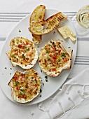 Gratinated prawns in scallop shells