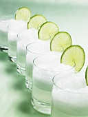 Drinks with ice cubes and slices of lime