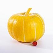 A pumpkin and a tomato