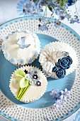 Elaborately decorated Louise's cupcakes with flowers and butterflies