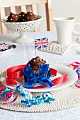 A chocolate cupcake decorated with a Union Jack