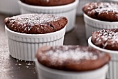 Individual Cakes Baked In Ramekins Dusted with Powdered Sugar