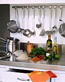 Kitchen utensils and ingredients in a stainless steel kitchen
