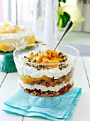 Peach trifle with pistachios and almonds
