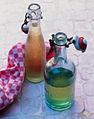 Two bottles of apple syrup
