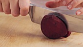 A beetroot being halved
