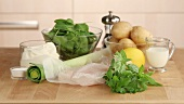 Ingredients for fish pie (fish fillet, creme fraiche, spinach and potatoes)