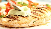 Grilled chicken breast being served with wasabi paste