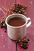 A mug of elderberry juice