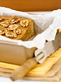 Walnut Blondies in a Parchment Lined Baking Pan; End Sliced Off