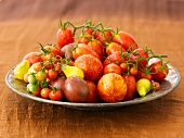A Variety of Freshly Washed Heirloom Tomatoes on a Large Plate