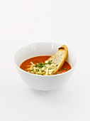 Bowl of Roasted Tomato Bisque with a Slice of Bread; White Background