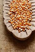 Corn kernels in a wooden bowl