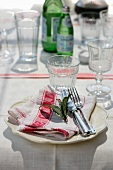 A simple place setting on a linen place mat
