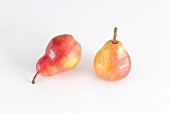 Two Red Bartlett pears