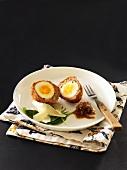 Scotch eggs with onion chutney