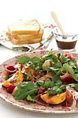 Nectarine salad with raspberries and ham