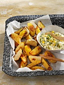 Roasted potato and kohlrabi wedges with a corn salad