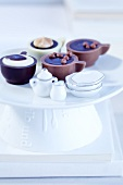 Cup-shaped pralines with doll's crockery