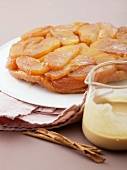 Peach tart with cinnamon sauce