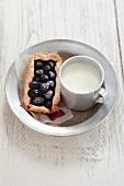 Grape tartlet and a mug of milk
