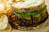Meatloaf Sandwich on Country Bread with Ketchup, Lettuce and Pickles; Potato Chips