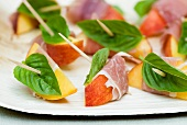 Peach Slices Wrapped with Ham and Basil; With Toothpicks