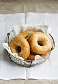 Sesame seed bagels in a breadbasket